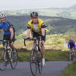 Cyclists on Tour of Wessex, climbing through Exmoor