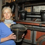 South Molton Museum curator Alison Rix with The Newsham Pump Engine from 1736.